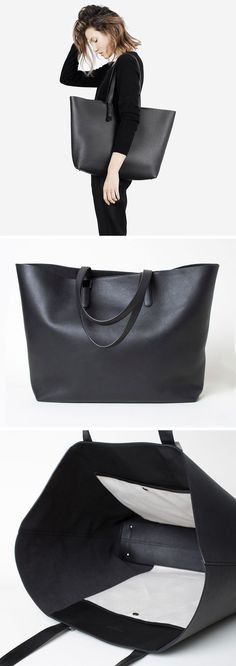 This large modern black leather tote has small feet on the bottom so you don't have to worry about setting it down on the floor.