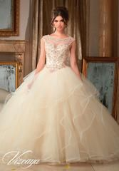 Stunning and elegant, Mori Lee Vizcaya Quinceanera Dress Style 89116 is sure to light up the room during any girl's Sweet 15 party. Made out of tulle, this Quince dress features a sleeveless sheer illusion neckline with pearl and crystal beading, back open keyhole, long flounced skirt trimmed with horsehair, and a lace-up corset back. A matching bolero jacket is included.  Colors: Champagne/Blush, Peacock/Turquoise, White  Please allow 4 - 5 months for delivery because Mori Lee ...