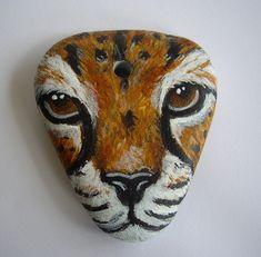 *Painted rock art.