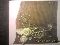 Quilling rose on the veneer greeting card