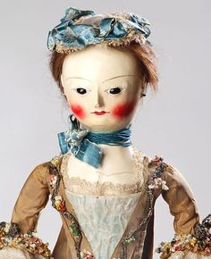 Fashion Doll, English. 1750-1760. Carved & jointed wood, gesso and painted, glass, human hair. Cap. Silk Sacque. T.90 to V-1980