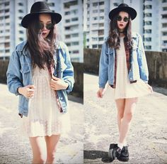 Pretty lacey dress, with loose casual shirt and denim. A harsher look added by the dark hat, shades and creepers