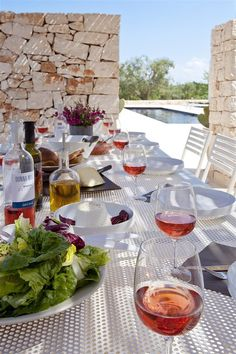 Villa Trullo Pinnacolo - the table is practical and also looks great. And who wouldn't love the long pool?