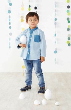 Baobab Pale Blue Knit Shirt - $41.95 - Funky boys knit shirt in pale blue by designer kids clothing brand Baobab!  Stylish and comfy, this long sleeve shirt is made from soft 100% cotton knit fabric with contrast colour poplin grandpa collar, button panel and pocket. #littlebooteek #boys #fashion #baobab