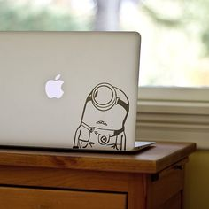 Minions MacBook Decal. Apple product not included. Made with technology safe vinyl. Adhesive doesn't damage the surface of Apple products. Please allow 15-20 days for US delivery/ 7-20 days for international delivery.