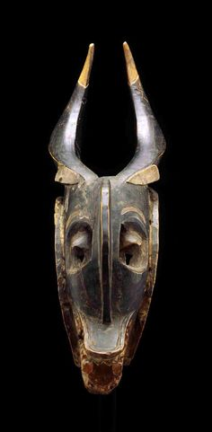 Africa | 'Zamblé' mask from the Guro people of the Ivory Coast | Wood and pigment | ca. 19th to early 20th century