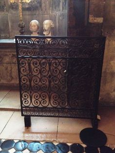 Black iron decorative scroll work patterned railing - summer 2015