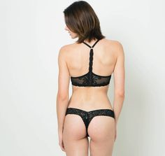 One of our best-selling styles, Feathers by Natori, now available as a black racerback. With lightly lined, flexible demi cups and embroidered lace detailing that appears smooth underneath clothing, this gorgeous and comfortable racerback is a must-have essential for any bra wardrobe. Features an accessible gold-tone front clasp that makes wearing this bra a breeze.