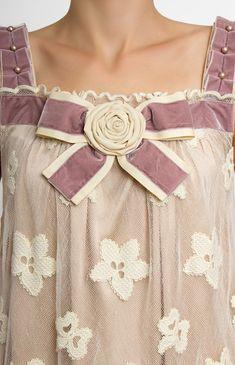 Silk-lace wool-pattern dress. Decoration with a velvet ribbon, beads and designer handmade rose. Hidden back zip closure. Genuine silk lining.