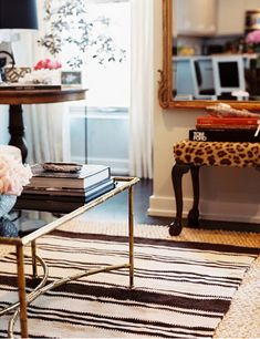 Love the leopard bench, mirror and coffee table. Oh, and the books:)