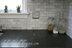 Love the Marble Backsplash w/ the Black Granite Countertops.  Granite is Virginia Jet Mist granite. Dark charcoal grey with random white veining.  Closest find to soapstone.  DIY Show Off ™ – DIY Decorating and Home Improvement Blog
