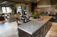 L-shaped kitchen island....with eating area and love the basket weave tile on backsplash