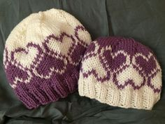 Free Knitting Pattern for Love the Winter Hat - Emily Dormier's beanie features a heart motif in stranded colorwork. Four sizes: baby, child, adult small, and adult large
