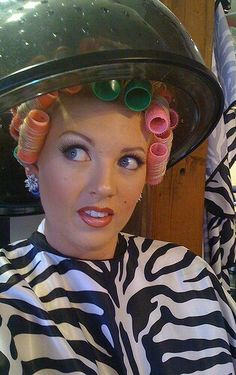 So pretty. Great makeup, and the curlers are fab!