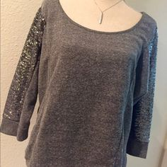 Gray Sequin Sweatshirt * NEW* Xhilaration Gray Sequin Sweatshirt.  Graphite color Sequins sewn on sleeves of sweatshirt.  60% cotton and 40% polyester.  Fun to wear casual with skinny jeans, stiletto and clutch or dress comfortable with sweats to keep warm on cold days.  NO tears, NO holes and NO missing sequins.  **Necklace not included with purchase. Xhilaration Sweaters Crew & Scoop Necks