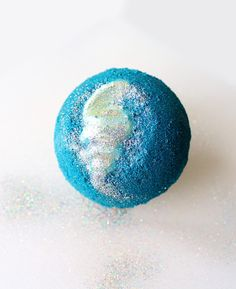 Mermaid Lagoon Bath Bomb Recipe! Learn how to DIY a mermaid lagoon bath bomb for a fun and colorful addition to your bath time ritual. This mermaid lagoon bath bomb recipe yields two large bath bombs with moisturizing cocoa butter shells.