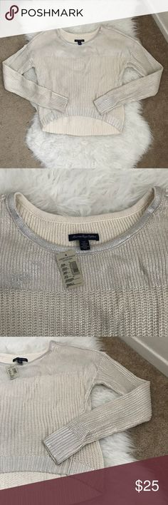 🦋2/$20🦋 🆕 American Eagle Metallic Cream Sweater Very cute cream with metallic silver like coating Crew Neck High Low Style Sweater by American Eagle Outfitters Size Small App measurements in photos! Material: 100% cotton New with tag! Like it? Send an offer! Or Bundle & Save More! 🤗 Thank you for stopping by my closet! Happy Poshing! 💞 American Eagle Outfitters Sweaters Crew & Scoop Necks