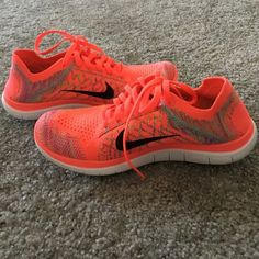 Nike free 4.0 flyknit Great condition, only worn once. Flyknit material. Bright orange with multicolor detail. Nike Shoes Sneakers