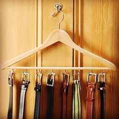 Belt rack from a wooden hanger DIY