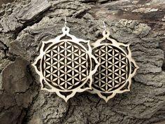 flower of life earrings - omg.