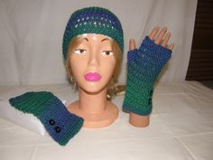 Hand crocheted slouchy beanie and fingerless gloves with button accents. Can be found at www.etsy.com/shop/HandCraftedByGailZ