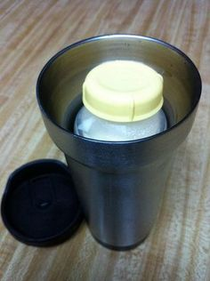 While on the go, heat up BM with simple trick: put a bottle of BM in a travel mug and add hot water to keep warm