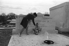 One of the many persons who visits the tomb of Dr. Martin Luther King Jr. daily adds flowers to a vase left by another mourner in Atlanta on April 4, 1969. (AP Photo/BJ) Photo: BJ, STR. This photograph examines healing through the leans of trauma and exemplifies the wounds that are prevalent in Black culture as a result of violence and death--specifically violent death. What does it mean to heal? What is the relationship between healing and memory?