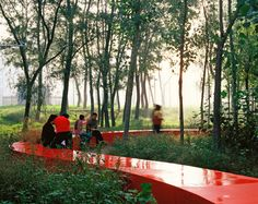 Completed in 2007 in Qinhuangdao, ChinaThe Red Ribbon running through this Qinhuangdao park can be seen against the background of natural terrain and vegetation, spanning 500 meters (547...