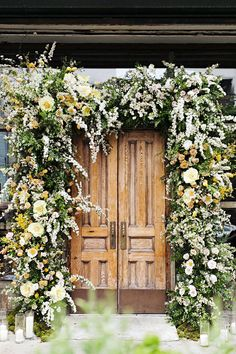 Showstopping floral displays, like this arch of Clair de Lune peonies, forsythia, roses, ranunculus, and spirea, were constructed by Putnam & Putnam.