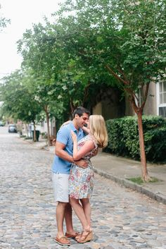 The cobblestone streets in downtown Charleston make for the best spots for your engagement photos! } - RIVERLAND STUDIOS