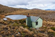 Tarn Hut, North Canterbury, is sited next to a small picturesque tarn in open alpine grassland. Close To Home, Open Spaces, Canterbury, Shelters, Cabins, Walks, New Zealand, In The Heights, Tiny House