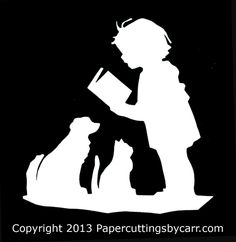 Scherenschnitte of a girl reading to her pets, traditional papercutting, without patterns or sketches. By Lawson and Harriett Carr.