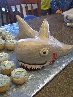 Host the ultimate Shark Party with these awesome shark crafts, shark food ideas, shark party favors and games for Shark Week for shark birthday parties! Shark Birthday Cakes, Shark Cake, Dinosaur Cake, Dinosaur Party, Shark Party, Ocean Party, Beach Party, Crazy Cakes, Novelty Cakes