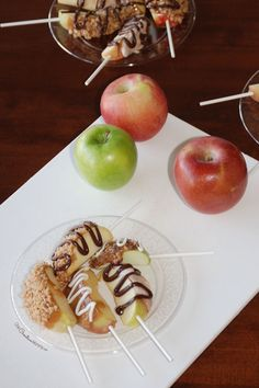Caramel Apple Pops: All the flavor of a caramel apple without the mess. These fancy apple slices on a stick are perfect for a tasting party or as a neighbor gift. {OneCreativeMommy.com} Caramel candy recipe included.