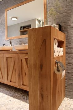 Bathroom storage.  My Dad would love this one.  He built one with swing out shelves to hold the tp
