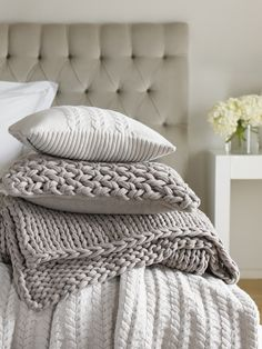 Commercial photography by Sarah Hogan cushion, pillow covers, knitted blankets, bedroom