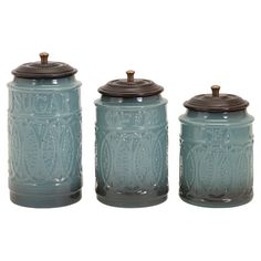 Add a touch of artful appeal to your entryway console table or living room etagere with these ceramic canisters, featuring a textured design.