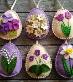 Felt easter decoration – purple felt eggs with spring flowers including lily of the valley flowers, violet flowers, tulips, daffodils and hydrangea flowers. Listing is for 6 ornaments: –…Felt crafts - how creative are you? Easter Projects, Easter Crafts, Felt Crafts, Fabric Crafts, Easter Decor, Decorating Easter Eggs, Felt Projects, Clay Crafts, Felt Flowers