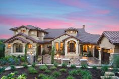 Jenkins Custom Homes built this lavish estate with Mediterranean influences, seen inside and out. The home has a gorgeous backyard that takes in the lake views, while the interior is a soothing space decorated luxuriously.