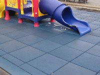 Eco-Safety Surfacing Playground Rubber Tiles for indoor or outdoor play areas.  Tiles are available in green, coal, terra cota, and blue.