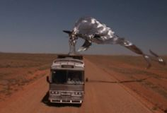 """COVERT SCIENCE-Directing 2nd-unit shots for Stephen King's """"Maximum Overdrive"""" outside Wilmington, N. Carolina in 1985, cameraman Tony L. was on a perch in back of a truck, filming from a high angle when, """"This silvery, globby THING swooped out of nowhere and latched onto the bus.  It was alive, definitely.  As far as shape, it was hard to tell because it kept changing, like it was part liquid.  My impression was that it was trying to make off with the damn bus!"""" """"Hoax or Smoking Gun?…"""