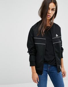 Buy it now. Le Coq Sportif Bomber Jacket With Piping - Black. Bomber jacket by Le Coq Sportif Smooth soft-touch outer Baseball collar Zip fastening Embroidered logo Contrast piping Functional pockets Ribbed trims Regular fit - true to size Machine wash 55% Polyester, 45% Cotton Our model wears a UK S/EU S/US XS and is 170cm/5'7 tall , chaquetabomber, elbowdiamond, baseball. Black Le coq sportif  bomber jacket  for woman.