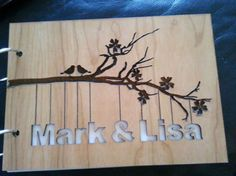 Each laser cut Bride Groom Guest book is cut from 3mm Cherry vaneer ply The Bride Groom s names are hanging from a laser etched branch The names are