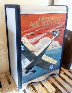 vintage poster used as inspiration for art on dresser front