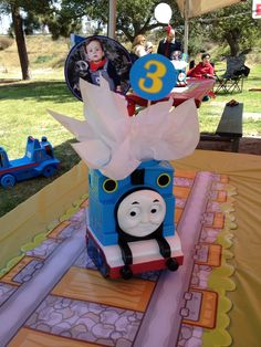 Thomas the train centerpiece with train track table runner. by Diana Alejandra Avery Mills Thomas Birthday Parties, Thomas The Train Birthday Party, Trains Birthday Party, Train Party, Birthday Party Themes, Car Party, Disney Cars Party, Thomas And Friends, Third Birthday