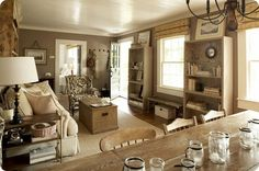 Do you see the amaizing bookshelves lined with old dictionary pages...and the jars on the farm table...and the simple windows!