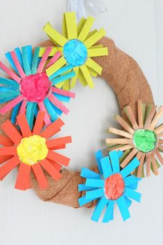 PAPER FLOWER WREATH -  Have too many paper tubes? Don't throw them away, make a pretty DIY paper flower wreath, perfect for holidays, weddings or parties!  #paper #papercraft #papercrafting #craft #crafting #crafts #craftsforkids #kidscraft #paperflowers #wreath