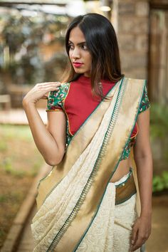 A super interesting blouse styled in a maroon bib zippered style with a green kalamkari body and a subtle sheer back. And don't miss the mustard piping addition!Pair with a maroon saree, a green saree. Or even a saree having green details and make your unique style statement! #kalamkari #saree #india #blouse #houseofblouse