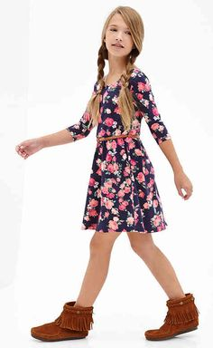 How younger Ezra dresses: Generally printed dresses with moccasins Maiara made for her.