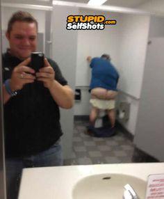 Funny Selfies: Public bathroom selfie gone wrong, really wrong.